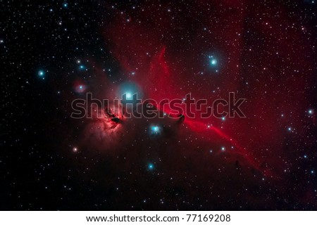 The Horsehead Nebula in Orion. The orange-red Flame Nebula NGC 2024, the deeply red nebulous stripe IC 434 with the high-contrast dark protrusion of the Horsehead Nebula.