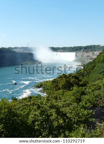 The Horseshoe Falls at Niagara Falls from the Canadian side of the falls - stock photo