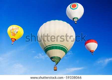 the hot air balloons on blue sky - stock photo