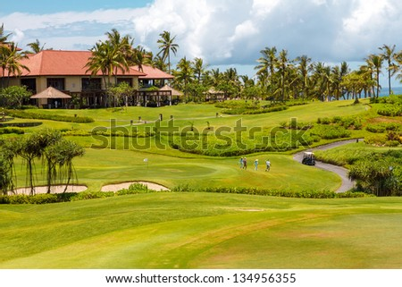 The hotel and golf course on a sunny day - stock photo