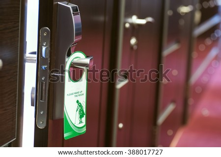 The hotel on the door hangs a charm with a request to clean the room & Hotel On Door Hangs Charm Request Stock Photo 388017727 - Shutterstock