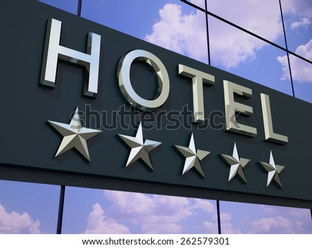 The hotel with a five stars  sign on the modern building facade.