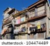 The house drying clothes on a small street in the old quarter of Ribeira - Porto, Portugal - stock photo