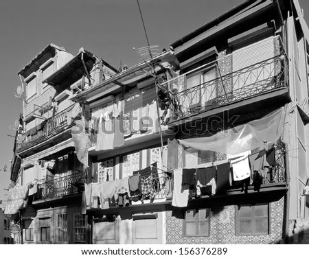 The house drying clothes on a small street in the old quarter of Ribeira - Porto, Portugal (black and white)