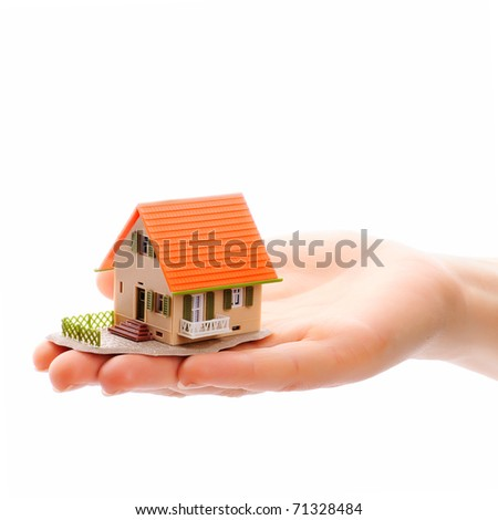 The house in human hand... - stock photo