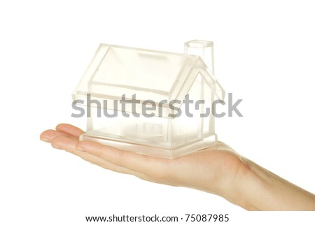 The house in human hand on white - stock photo