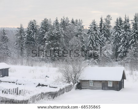 The house in village in the winter - stock photo