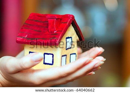 The house in woman hands - stock photo