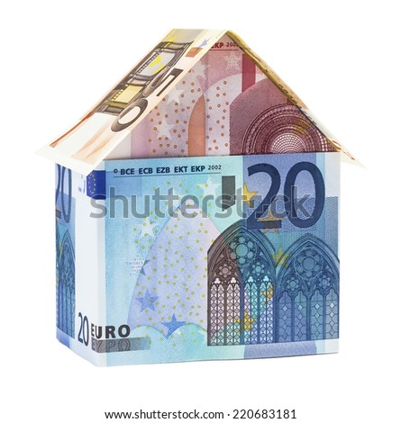 The house made of Euro banknotes, isolated on white. - stock photo