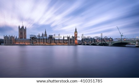The house of parliament and Big Ben seen from Westminster Bridge at sunset. This is the most famous landmark in London, UK. Long exposure technique has been used. - stock photo