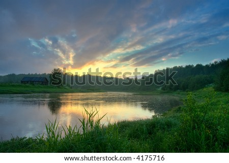 The house on coast of the river - stock photo