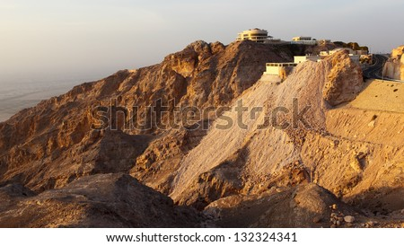 The house on mountain is shown on a sunset. AL AIN. United Arab Emirates - stock photo