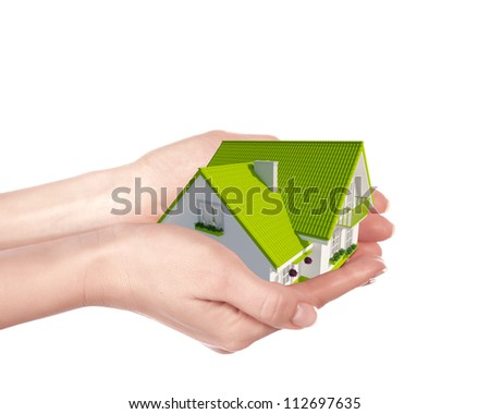 The house with colour roof in human hands - stock photo