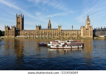 The Houses of Parliament and the Clock Tower in London, England, UK - stock photo