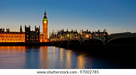 The Houses of Parliament and Westminster Bridge at dusk - stock photo
