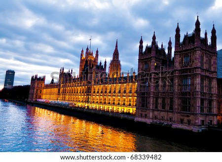 The Houses of Parliament in London in a cloudy day - stock photo