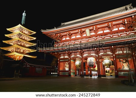 The Hozomon gate of the Asakusa temple with the pagoda at night in Tokyo - stock photo