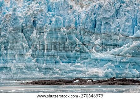 The Hubbard Glacier while melting in Alaska - stock photo