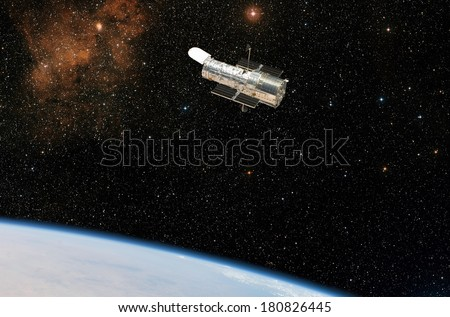 The Hubble Space Telescope observes deep space while in orbit above the Earth. Elements of this image furnished by NASA.  - stock photo
