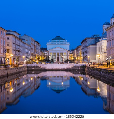 The huge church of St. Antonio Thaumaturgo is situated by Canale Grande. Its neo classical front facade and cupola represents one of emblems of Trieste, city and seaport in northeastern Italy, Europe. - stock photo