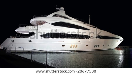 The huge 38 meter three floor luxury yacht parked in the water of Marina, Dubai. - stock photo