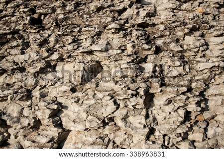 The huge wall of limestone rock from the mining industry - stock photo
