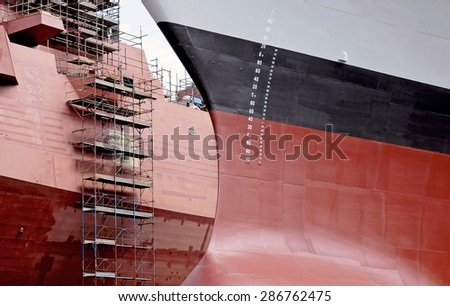 The hull of a warship under construction in the shipyards.  - stock photo