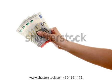The human arm holds 5 euro banknotes