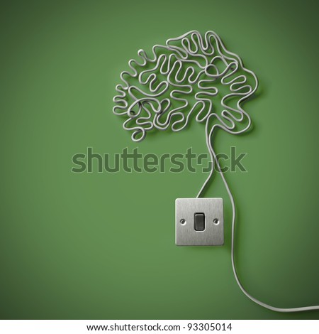the human brain made from electric cable with a light switch - stock photo