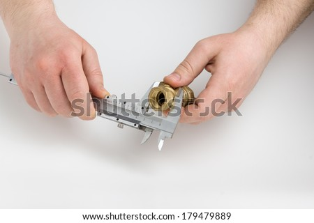the human hand holds the measuring instrument on a white background - stock photo