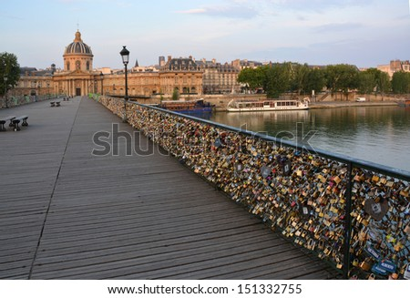 The hundreds of thousands of romantically love inscribed padlocks on the Pont Des Arts Bridge, Paris France. - stock photo