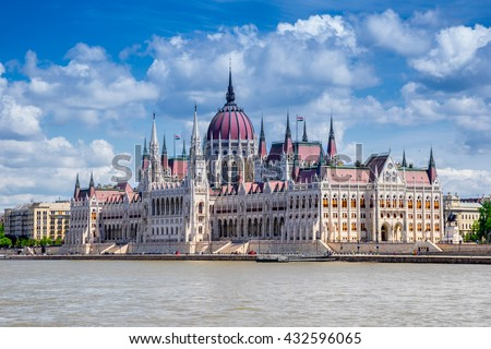 The Hungarian Parliament on the Danube River in Budapest - stock photo