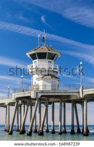 The Huntington Beach Pier Vertical Image in Huntington Beach, California. - stock photo