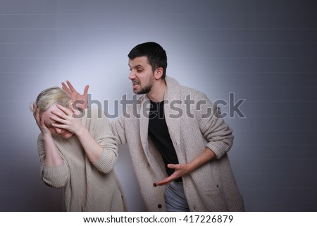 The husband yells at his wife. Family quarrels, violence in the family.  - stock photo