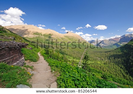 The iceberg lake trail in Glacier National Park looking into the swiftcurrent valley - stock photo
