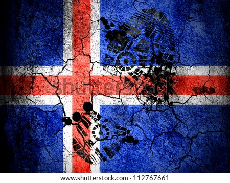 The Icelandic flag painted on cracked ground with vignette with dirty oil footprint over it