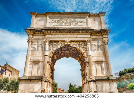 The iconic Arch of Titus on the Via Sacra in the Roman Forum, Rome, Italy - stock photo