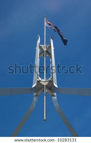 the iconic australian flag on top of parliament house canberra - stock photo