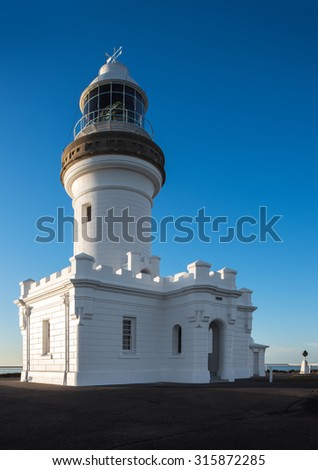 The Iconic Cape Byron Lighthouse on Top of a Hill With a Clear Blue Sky During Sunrise, the Most Eastern Point of the Australian Mainland, Byron Bay, New South Wales - stock photo