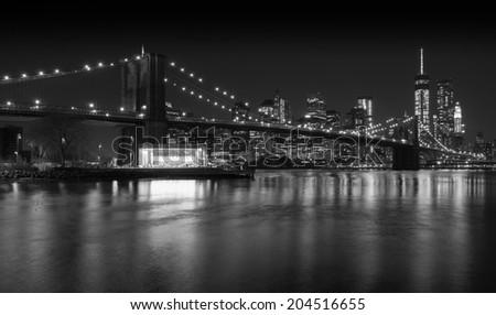 The iconic Manhattan skyline and Brooklyn bridge, Brooklyn, NY, USA - stock photo