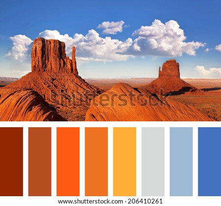 The iconic Mitten Butte rock formations of Monument Valley, in a colour palette with complimentary swatches - stock photo