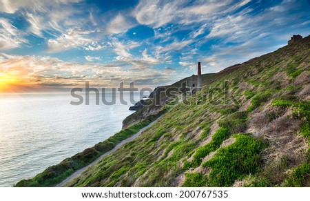 The iconic ruins of the Wheal Coates engine house perched on cliffs on the Cornwall coast at St Agnes - stock photo