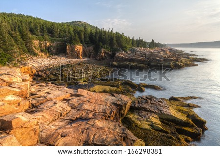 The iconic sharp rocky coastline of Maine at Monument Cove in Acadia National Park, Maine - stock photo