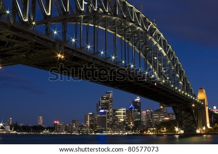 The Iconic Sydney Harbour Bridge against the Blue Evening Sky - stock photo