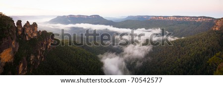 The iconic Three Sisters at dawn in the Blue Mountains National Park, near Katoomba, NSW, Australia - stock photo