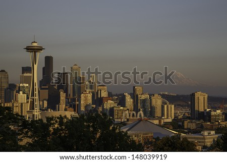 The iconic view of the Seattle skyline at sunset from Kerry Park with  Mount Rainier on the horizon. - stock photo