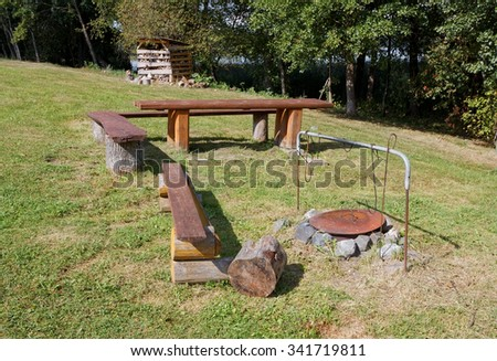The ideal place for a tourist fire and coppers with food in the european forest - stock photo