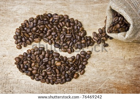 The image is laid out coffee beans on the background of the old board