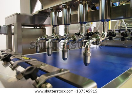 The image of a bakery conveyor - stock photo