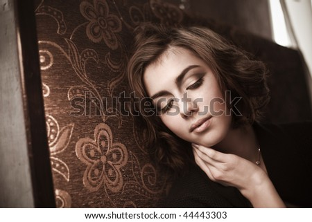 The image of a beautiful girl in a cafe - stock photo